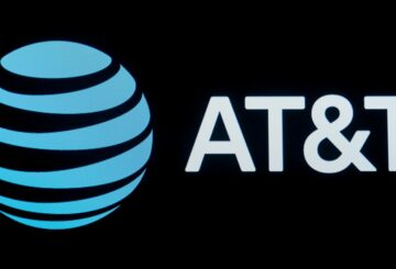 The company logo for AT&T is displayed on a screen on the floor at the New York Stock Exchange (NYSE) in New York, U.S., September 18, 2019. REUTERS/Brendan McDermid