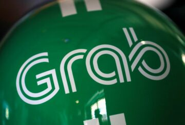 A Grab logo is pictured at the Money 20/20 Asia Fintech Trade Show in Singapore March 21, 2019. REUTERS/Anshuman Daga/File Photo/File Photo
