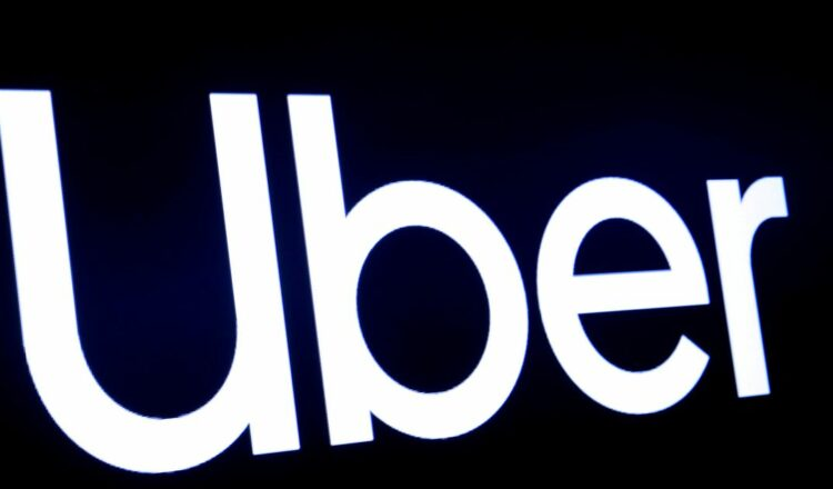A screen displays the company logo for Uber Technologies Inc at the New York Stock Exchange (NYSE) in New York, U.S., May 10, 2019. REUTERS/Brendan McDermi