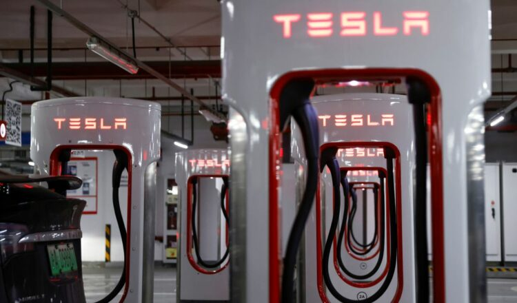 Tesla charging stations are pictured in a parking lot in Shanghai, China March 13, 2021. REUTERS/Aly Song