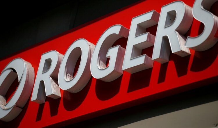 A sign is pictured outside a Rogers Communications retail store in Ottawa, Ontario, Canada July 20, 2017. REUTERS/Chris Wattie