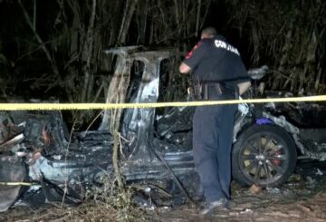 The remains of a Tesla vehicle are seen after it crashed in The Woodlands, Texas, April 17, 2021, in this still image from video obtained via social media. Video taken April 17, 2021. SCOTT J. ENGLE via REUTERS