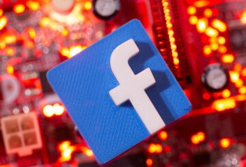 A 3D printed Facebook logo is placed on a computer motherboard in this illustration taken January 21, 2021. REUTERS/Dado Ruvic/Illustration/File Photo