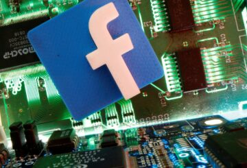 The Facebook logo is seen on a screen in this picture illustration taken December 2, 2019. REUTERS/Johanna Geron/Illustration