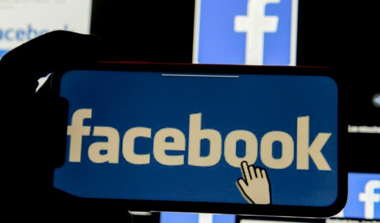 A 3D-printed Facebook logo is seen placed on a keyboard in this illustration taken March 25, 2020. REUTERS/Dado Ruvic/Illustration