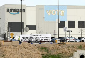 Banners are placed at the Amazon facility as members of a congressional delegation arrive to show their support for workers who will vote on whether to unionize, in Bessemer, Alabama, U.S. March 5, 2021.  REUTERS/Dustin Chambers