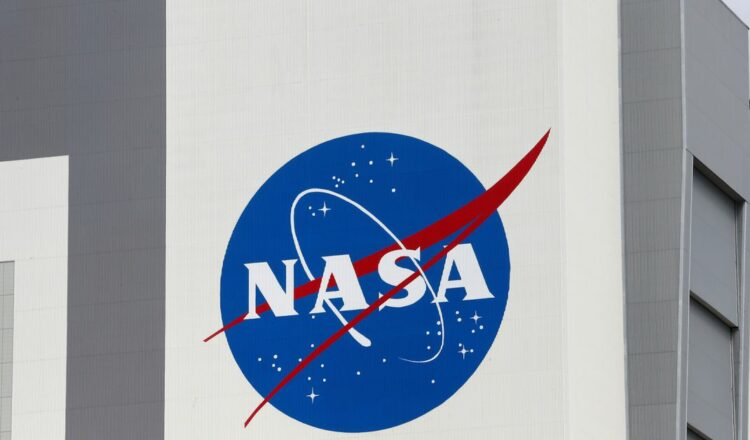 The NASA logo is seen at Kennedy Space Center ahead of the NASA/SpaceX launch of a commercial crew mission to the International Space Station in Cape Canaveral, Florida, U.S., April 16, 2021. REUTERS/Joe Skipper
