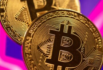 A representation of virtual currency Bitcoin is seen in front of a stock graph in this illustration taken March 15, 2021. REUTERS/Dado Ruvic/Illustration