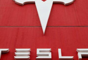 The logo of car manufacturer Tesla is seen at a branch office in Bern, Switzerland October 28, 2020. REUTERS/Arnd Wiegmann
