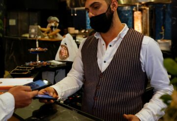 A customer makes a payment for a kebab at a restaurant that accepts Bitcoin and Dexchain in Istanbul, Turkey, April 27, 2021. Picture taken April 27, 2021. REUTERS/Umit Bektas
