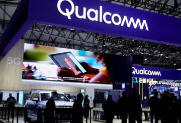People visit a Qualcomm booth at the Mobile World Congress (MWC) in Shanghai, China February 23, 2021.   REUTERS/Aly Song