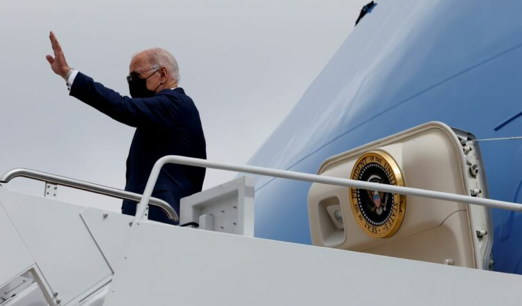 U.S. President Joe Biden waves as he boards Air Force One for travel to Michigan from Joint Base Andrews, Maryland, U.S. October 5, 2021. REUTERS/Jonathan Ernst