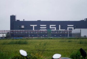 A Tesla sign is seen at its factory in Shanghai, China, May 13, 2021. REUTERS/Aly Song/Files