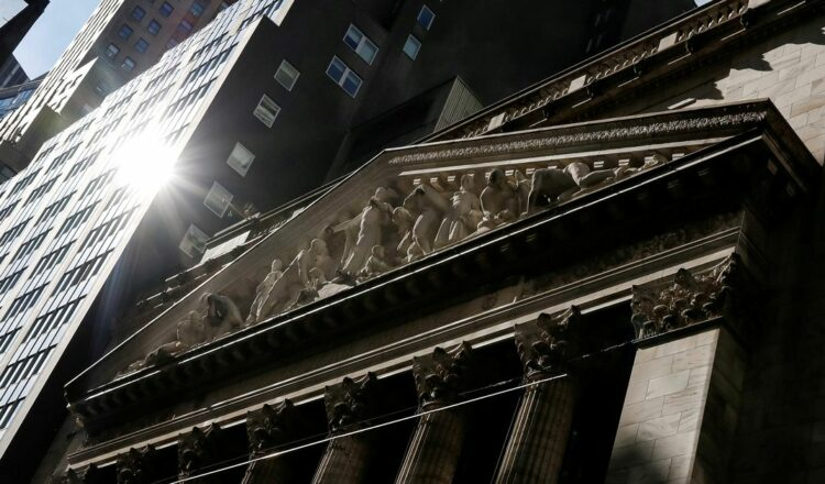 The front facade of the New York Stock Exchange (NYSE) is seen in New York, U.S., February 16, 2021. REUTERS/Brendan McDermid/File Photo